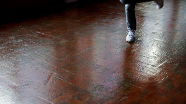 Female feet dancing breakdance on the dance floor, Close-up shot of dancing feet video