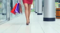 Female feet walking around the store, close up, Slow motion video