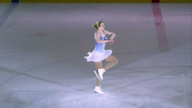 SLO MO Female figure skater ending performance with a spin video