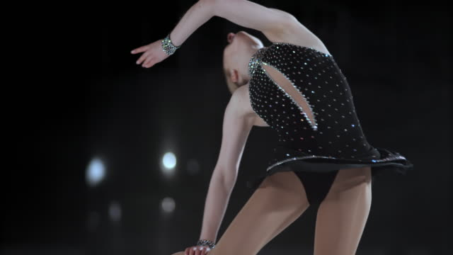 SLO MO TU Female figure skater in elegant layback spin video