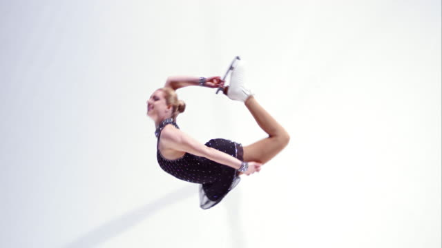 SLO MO Female figure skater performing variation of circle spin video