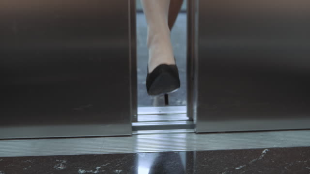 SLO MO DS Female foot stopping the elevator door video