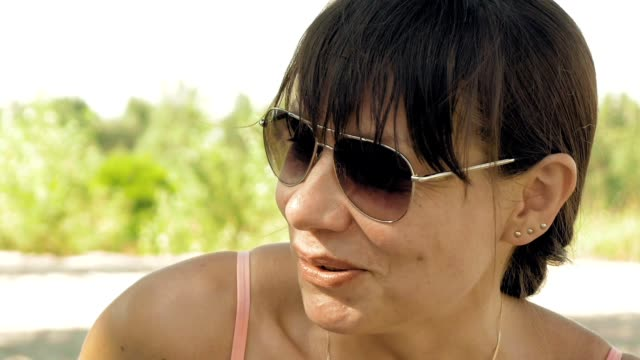 Female friend talking and having fun on the beach video