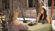Female Friends At Bar Drinking Coffee Smoking E-Cig video