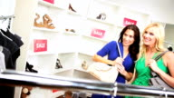 Female Friends Choosing Clothes Chic Boutique video
