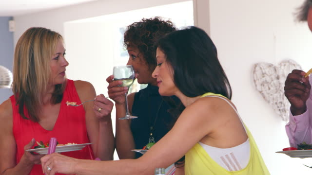Female Friends Enjoying Buffet At Dinner Party Shot On R3D video