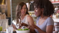 Female Friends Enjoying Lunch In Restaurant Shot On R3D video