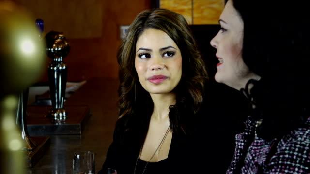 Female friends having fun in a bar video
