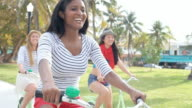 Female Friends Having Fun On Bicycle Ride video