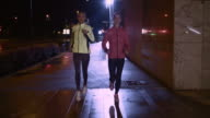 TS Female friends jogging in the city at night video
