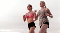 SLO MO TS Female friends jogging together and smiling video