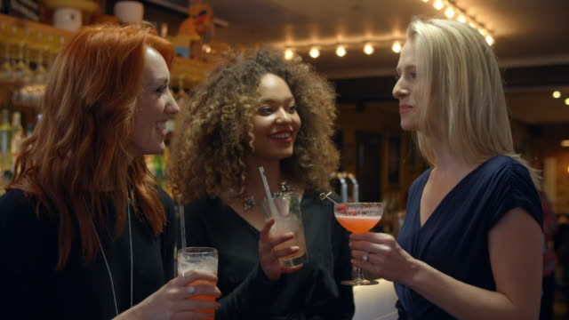 Female Friends Meeting For Evening Drinks In Cocktail Bar video