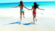 Female friends playing on beach video