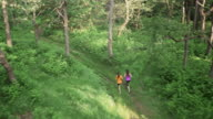 AERIAL Female friends running in forest video