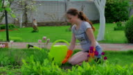 Female gardener showing thumbs up video