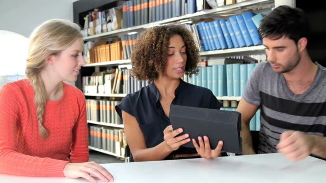 Female giving presentation on ipad video