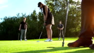 Female golfer shoots for the target video