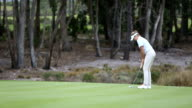 Female golfer takes a putt and misses video