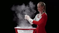 SLO MO Female gymnast clapping wrapped hands over chalk bowl video