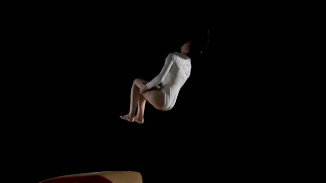 SLO MO DS Female gymnast performing her routine on the vault video