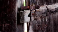 Female hand closes old wooden door with an iron latch video