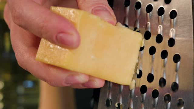 Female Hand Grating Cheese video