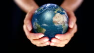 Female hand holding a realistic Earth. Starting in Europe. video