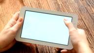 Female hand holding digital tablet. video