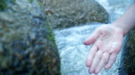 Female hand in water stream video