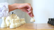 female hand makes the first move in chess video