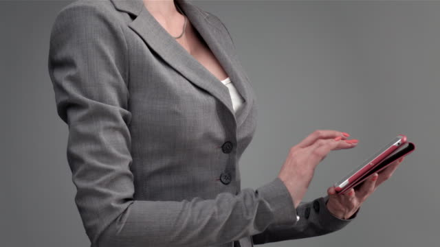 Female Hand Touching Tablet Computer Screen video