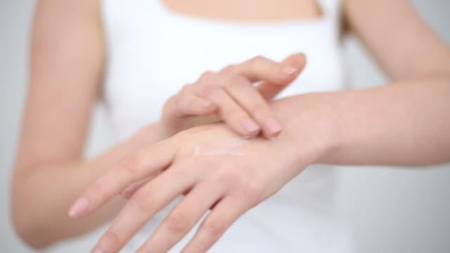 Female hands applying hand cream video
