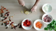 Female Hands Cutting Garlic, Making Salad. Top View Chief Cutting Vegetables. Healthy Lifestyle, Diet food video