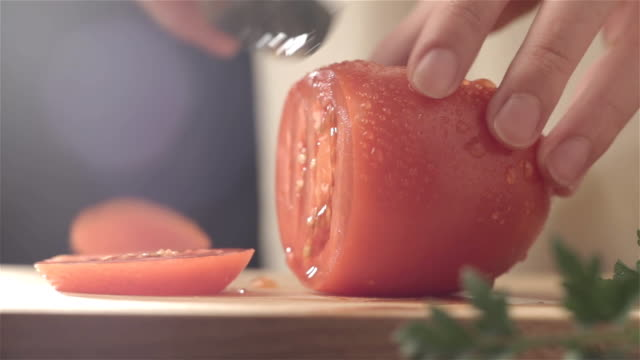 Female hands cutting tomato video