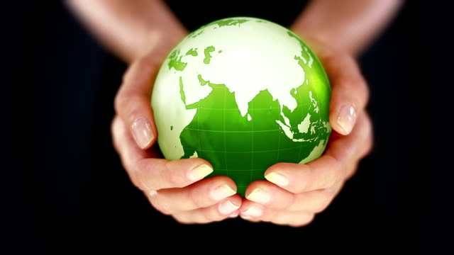 Female hands holding the Earth. Starting in Asia. Green. video