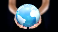 Female hands holding the Earth. Starting in Europe. Cyan. video