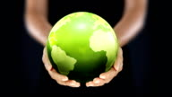 Female hands holding the Earth. Starting in Europe. Green. video