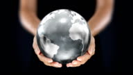 Female hands holding the Earth. Starting in Europe. Silver. video