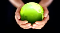 Female hands holding the Earth. Starting in US. Green. video