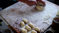 Female hands kneading dough in flour video