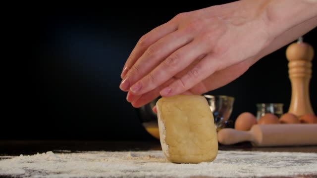 Female Hands Kneading Dough on the Table video