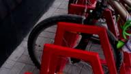 Female hands locked bicycle lock on parking video