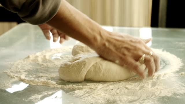 female hands making yeast dough video