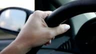 Female hands on the steering wheel video