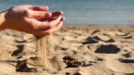 Female hands playing with sand video