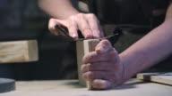 Female hands sanding wood video