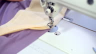 Female hands sewing on professional sewing machine. video