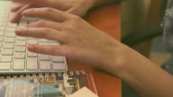 Female hands typing on a white keyboard video