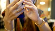 female hands using a smart phone video