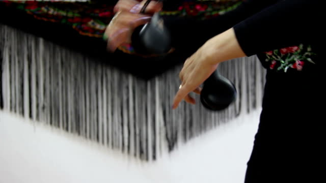 female hands with castanets beat the rhythm video